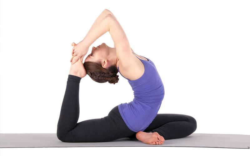 Tập thể dục thể thao, yoga là một trong những biện pháp giảm đau lưng hiệu quả